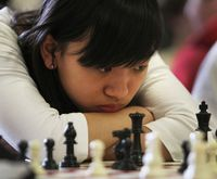 Chess girl thinking hard