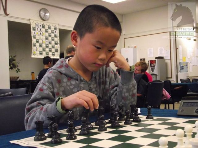 Tony Tang prepares his first move with the Black pieces