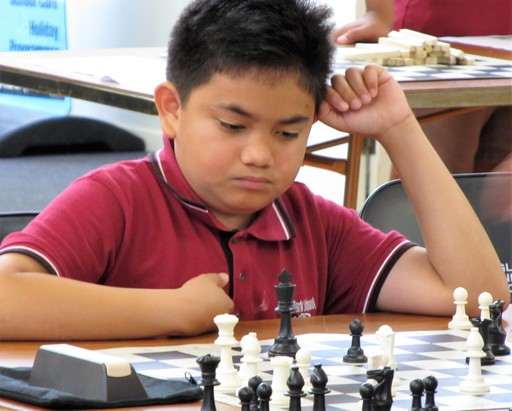Student participating in Chess Power cluster event